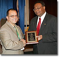 Photograph - Edgar de Leon Izeppi receives the Best Paper Award in the Transportation Applied Technology category