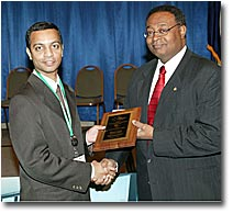 Photograph - Nilesh Joshi receives the Best Paper Award in the Transportation Safety category